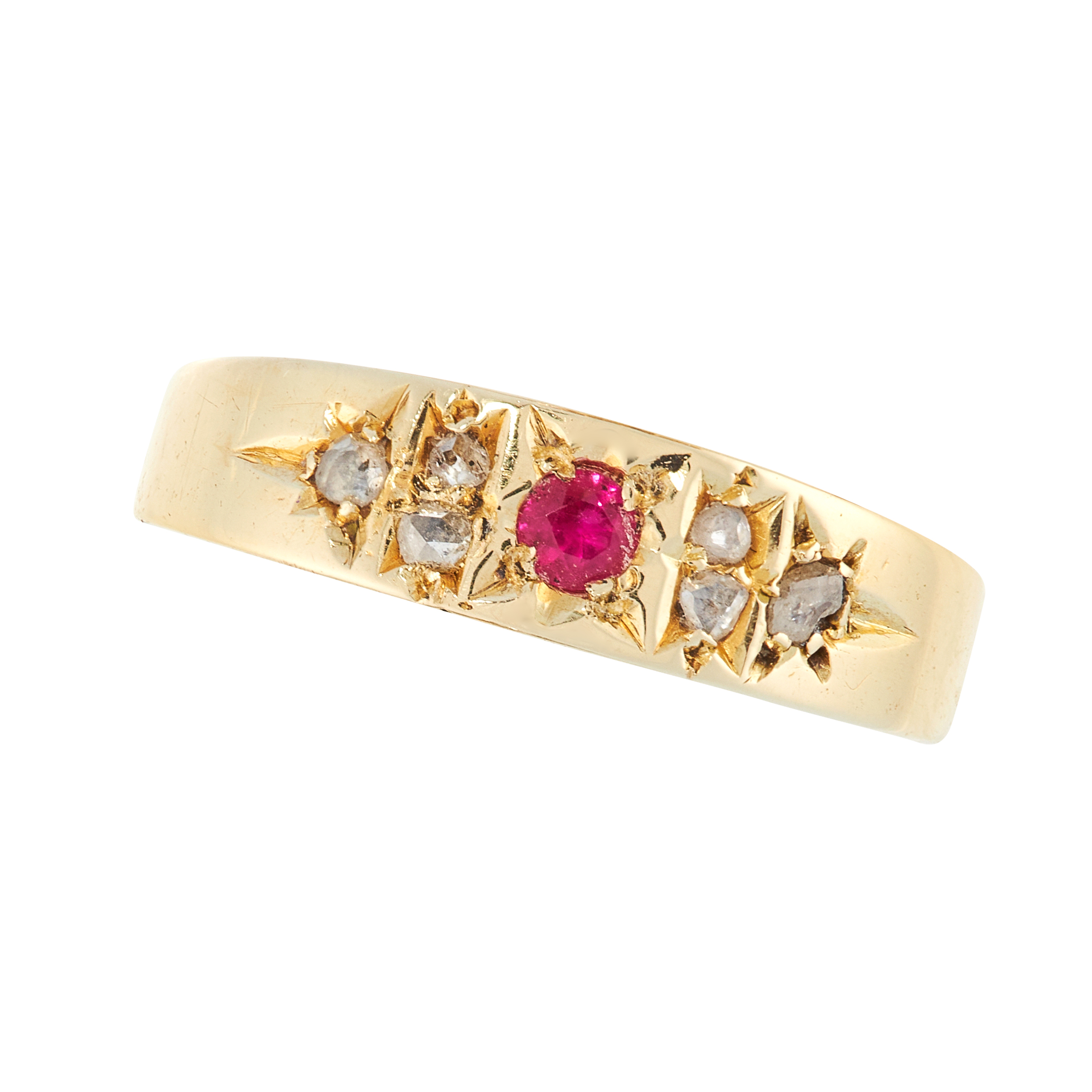 AN ANTIQUE RUBY AND DIAMOND DRESS RING, CIRCA 1900 in 15ct yellow gold, the tapering band set with a