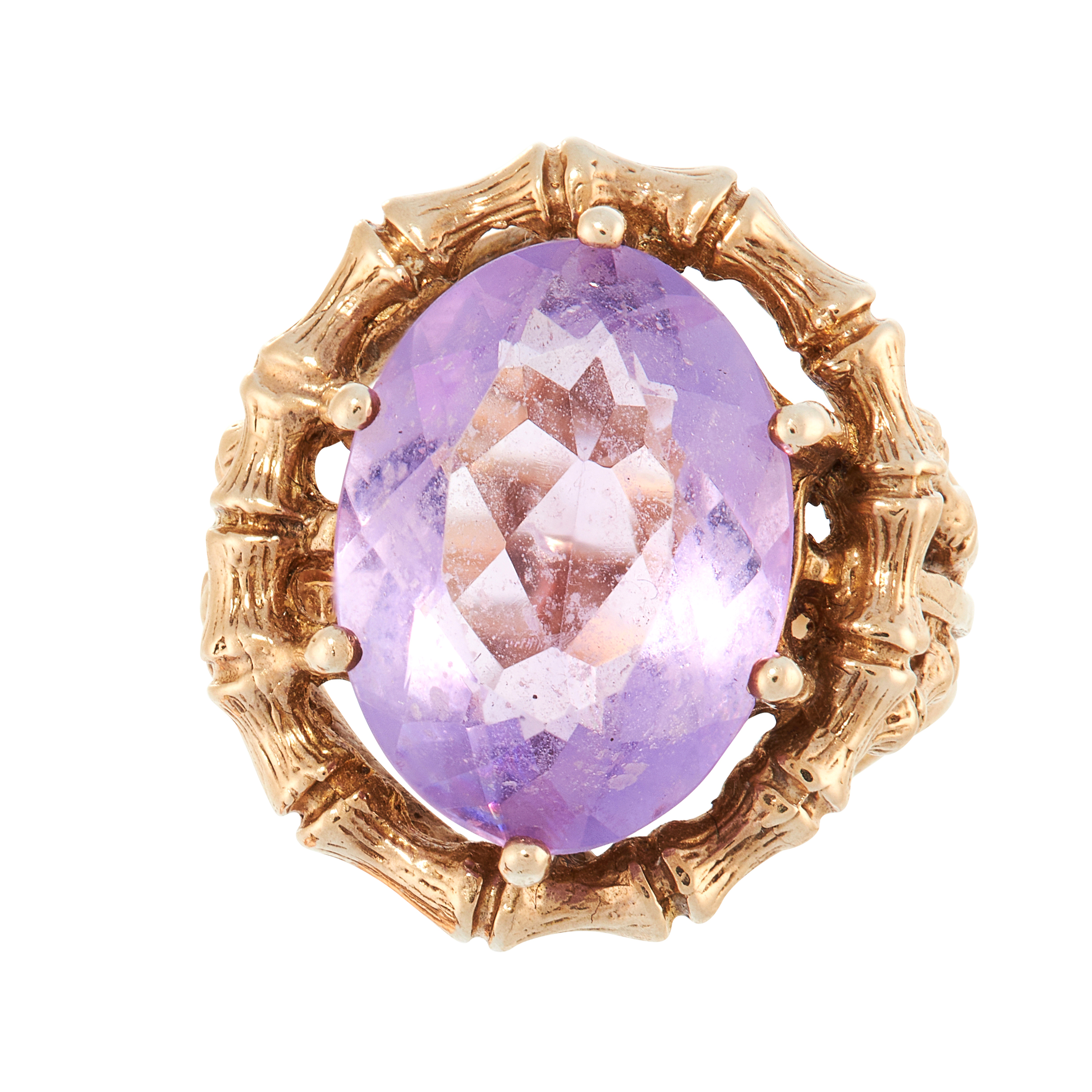 A VINTAGE AMETHYST DRESS RING, 1970 in yellow gold, set with an oval cut amethyst within a Chinese