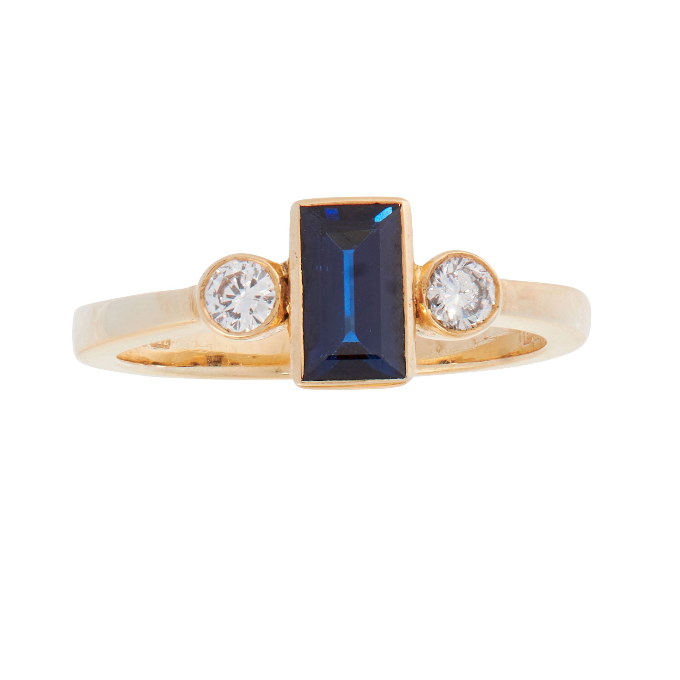A SAPPHIRE AND DIAMOND DRESS RING in 18ct yellow gold, set with a step cut blue sapphire between two