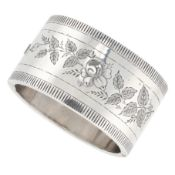 AN ANTIQUE VICTORIAN CUFF BANGLE, 1882 in sterling silver, the band with engraved foliate designs