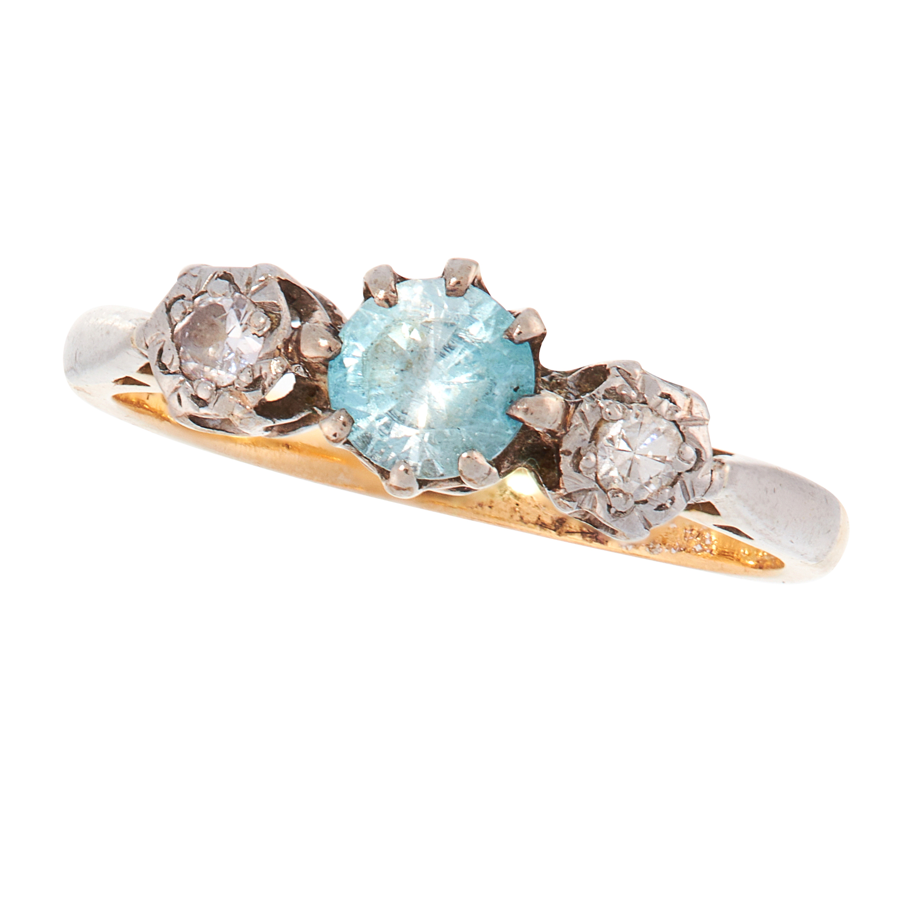 A BLUE ZIRCON AND DIAMOND DRESS RING, CIRCA 1930 in 18ct yellow gold and platinum, set with a