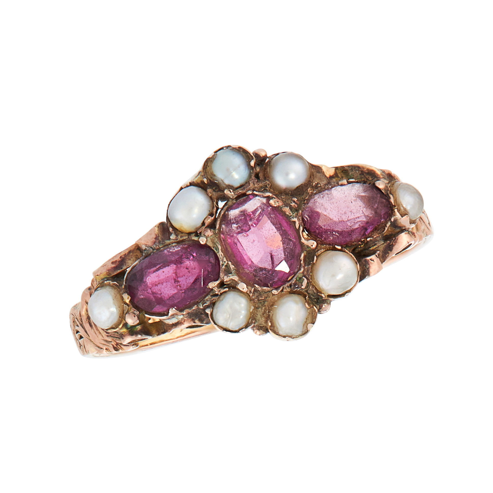 AN ANTIQUE GARNET AND PEARL DRESS RING in 12ct yellow gold, set with a trio of oval cut garnets