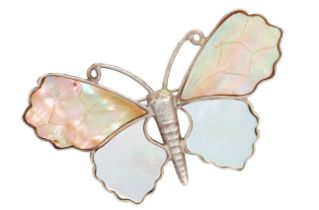 A MOTHER OF PEARL BUTTERFLY BROOCH in silver, designed as a butterfly, the wings set with polished