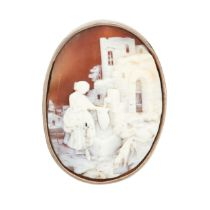 AN ANTIQUE CAMEO BROOCH in silver, set with an oval carved shell cameo depicting a scene of a lady