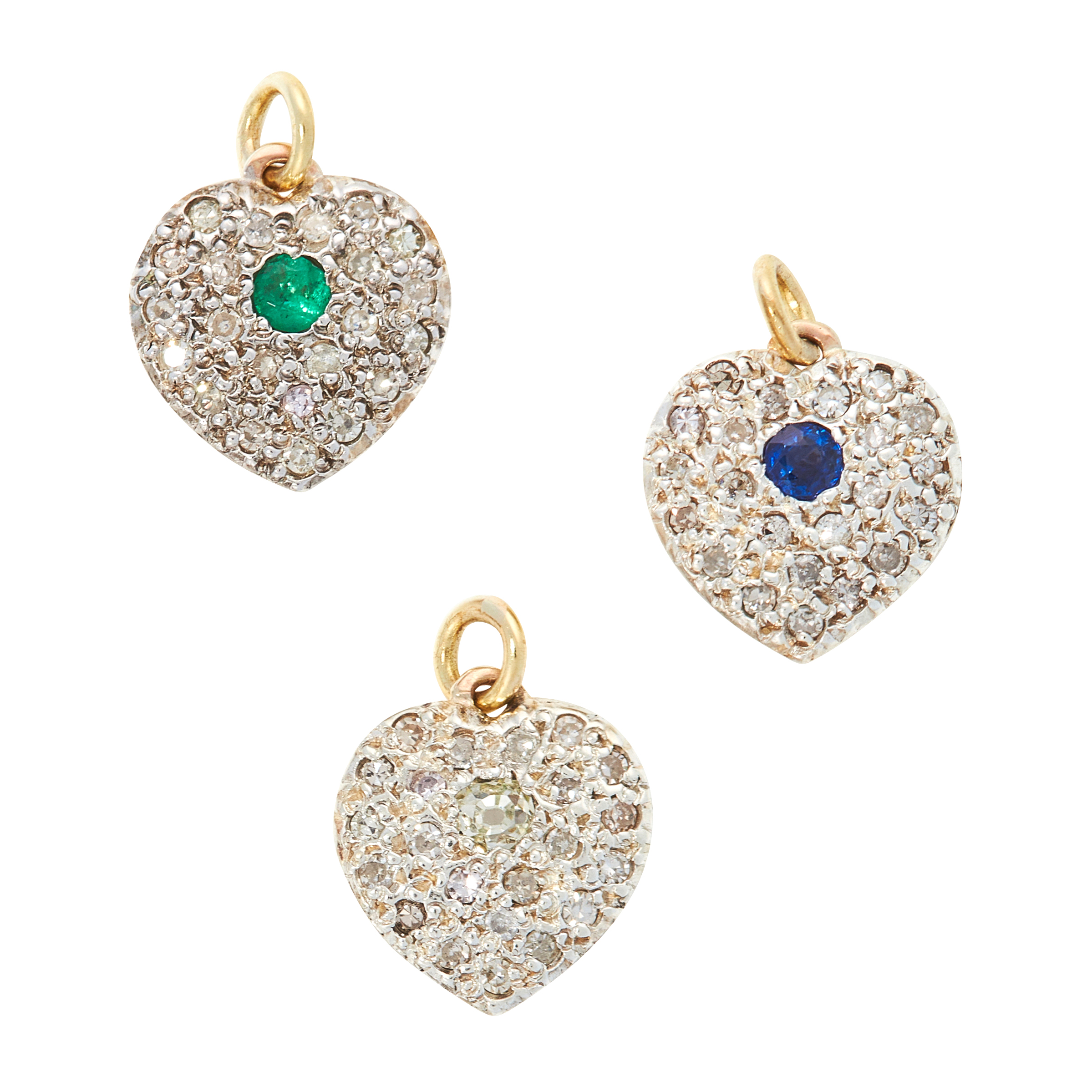 THREE SAPPHIRE, EMERALD AND DIAMOND HEART CHARMS / PENDANTS in yellow gold and silver, each designed
