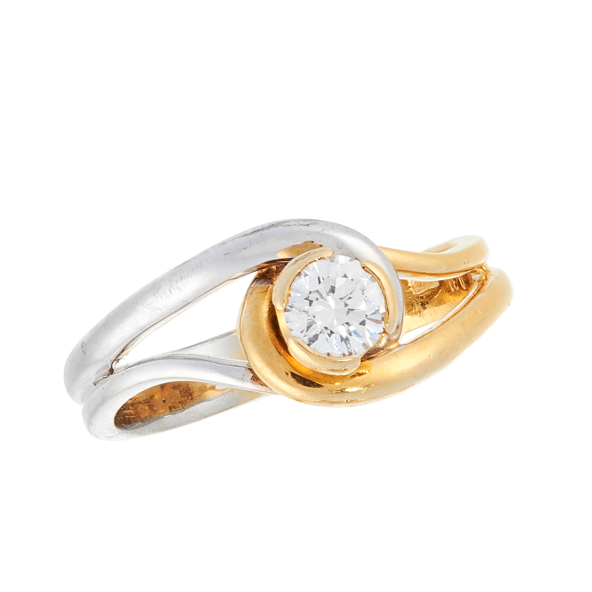 A SOLITAIRE DIAMOND DRESS RING in 18ct yellow and white gold, the band formed of interlocking loops,
