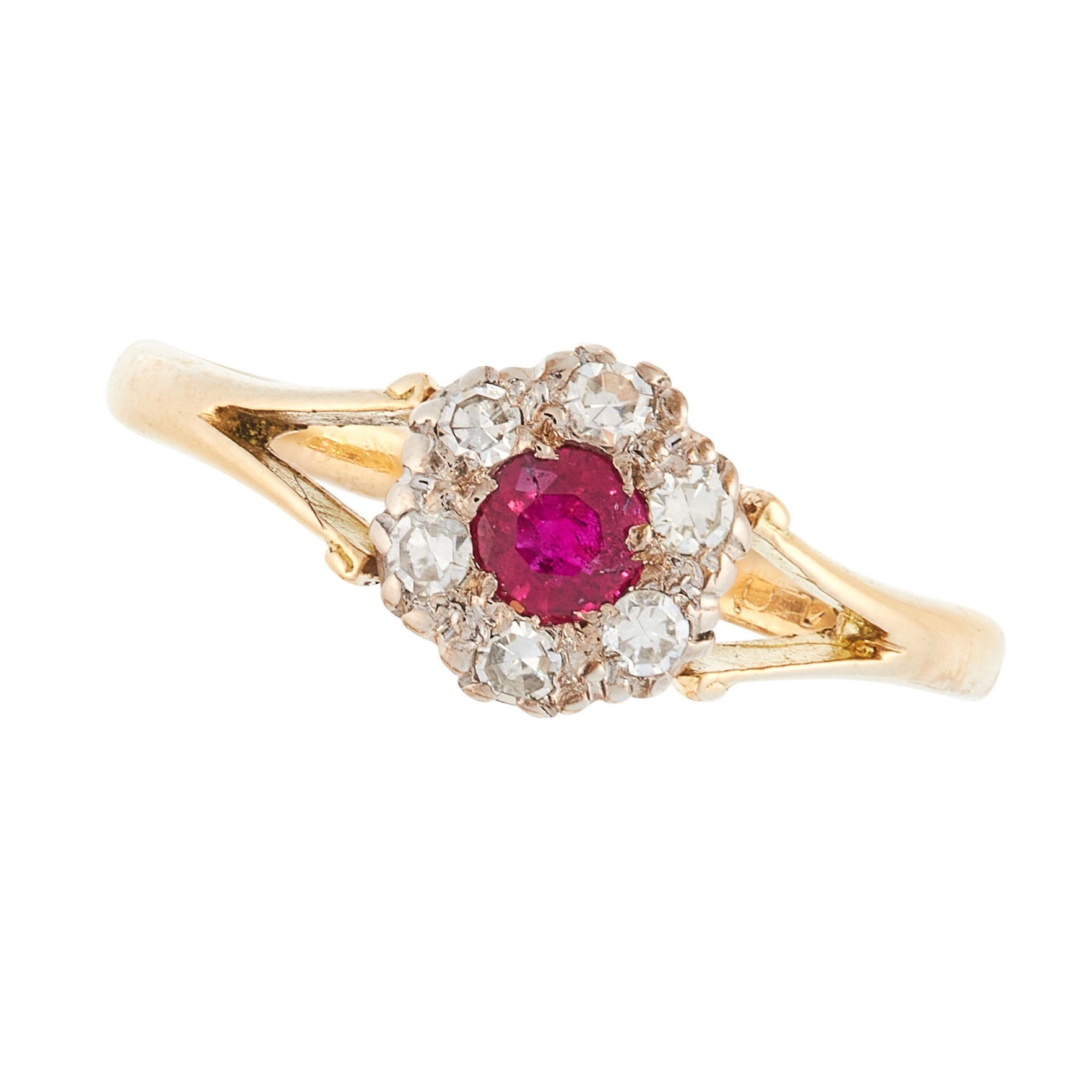 A RUBY AND DIAMOND DRESS RING, EARLY 20TH CENTURY in 18ct yellow gold, set with a round cut ruby