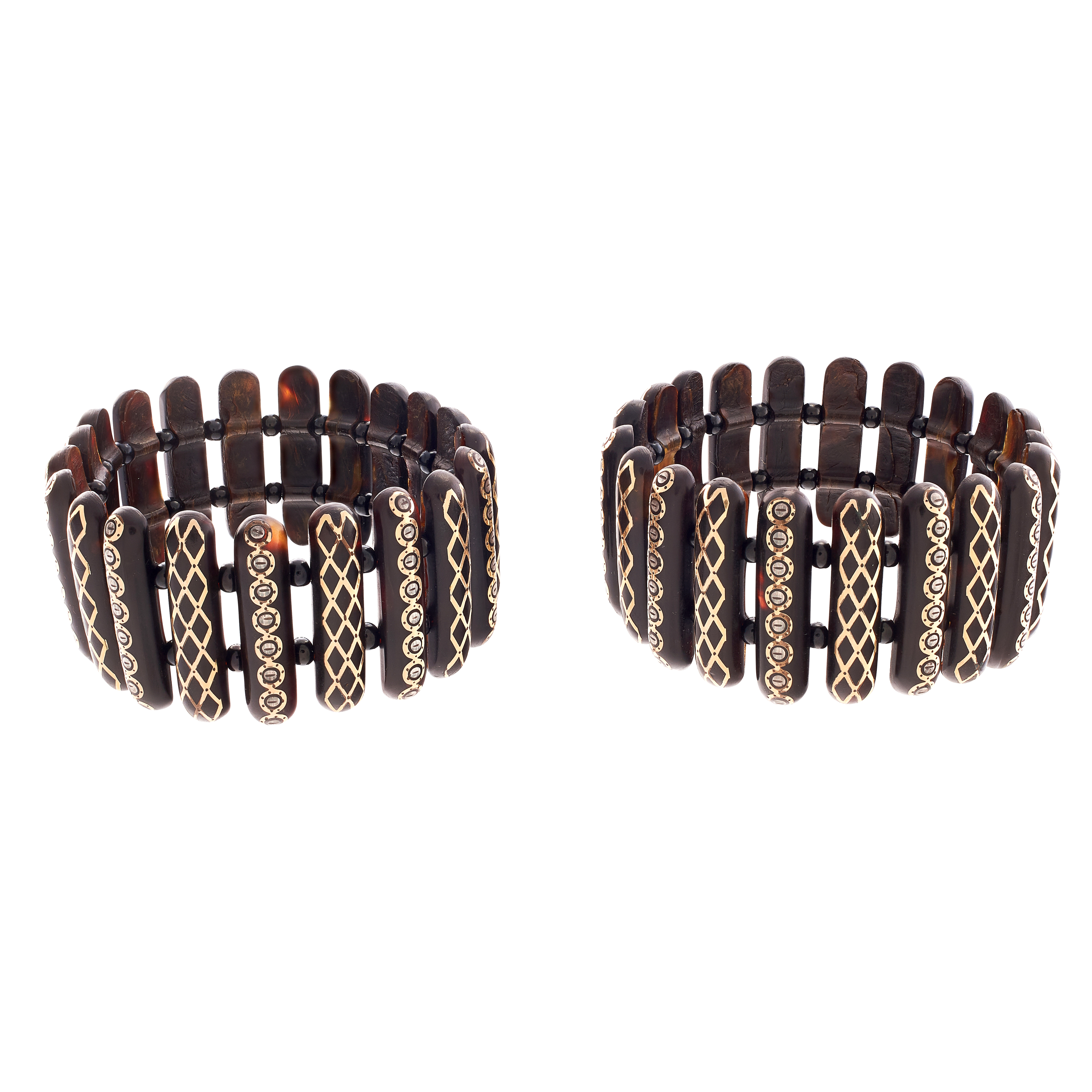 A PAIR OF ANTIQUE PIQUE TORTOISESHELL BRACELETS set with pique batons, spaced by tortoiseshell