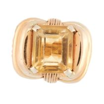 A VINTAGE CITRINE DRESS RING in 18ct yellow gold, set with an emerald cut citrine within a ribbon