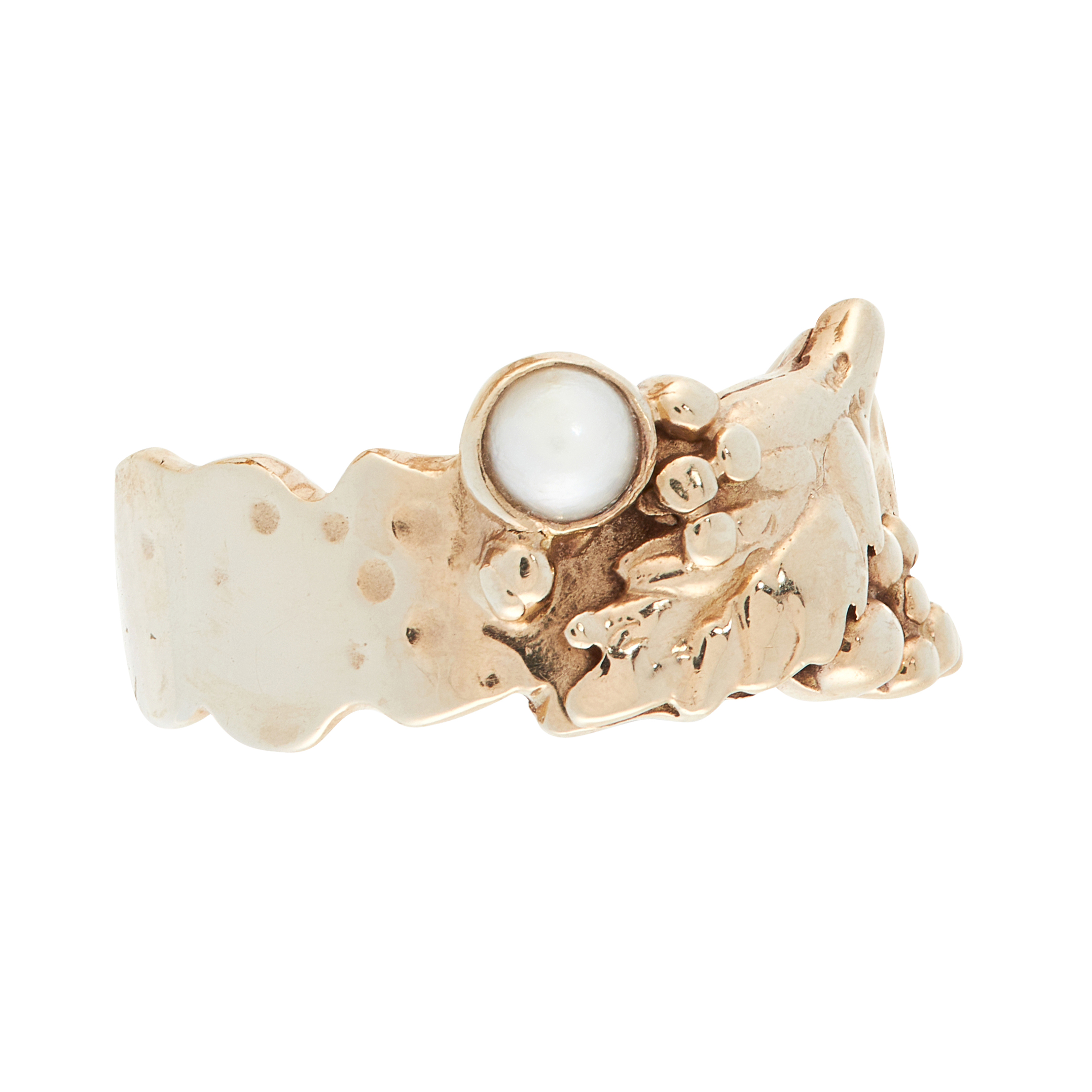 A VINTAGE PEARL DRESS RING in yellow gold, the stylised band formed of grape and vine motifs, set