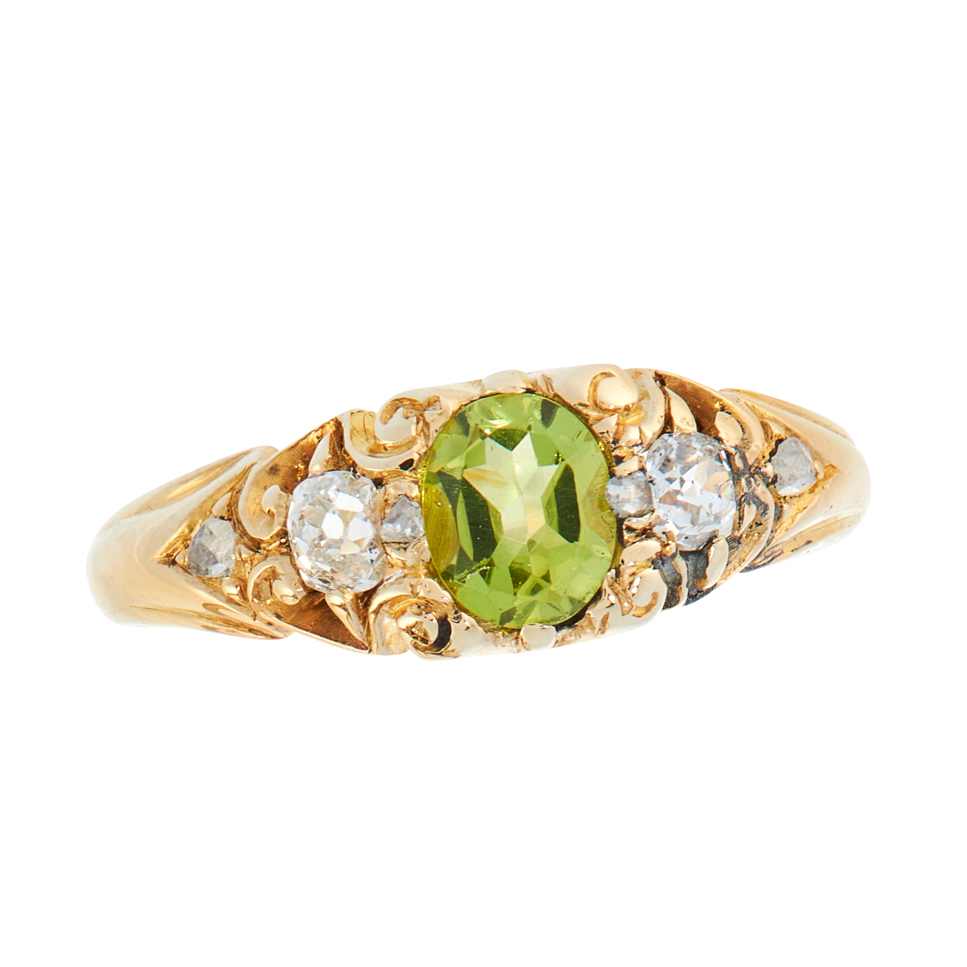 AN ANTIQUE PERIDOT AND DIAMOND DRESS RING, CIRCA 1900 in high carat yellow gold, set with an oval