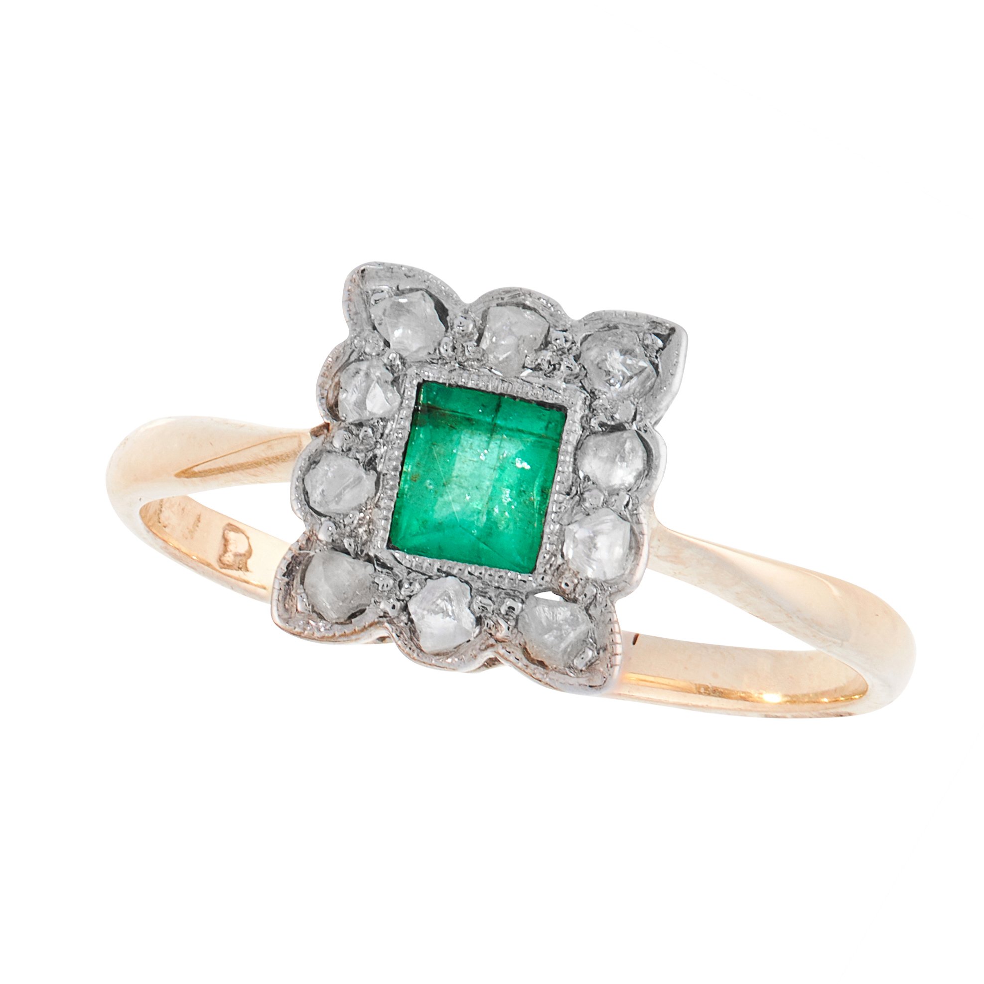 AN ART DECO EMERALD AND DIAMOND DRESS RING in 18ct yellow gold, set with a French cut emerald within