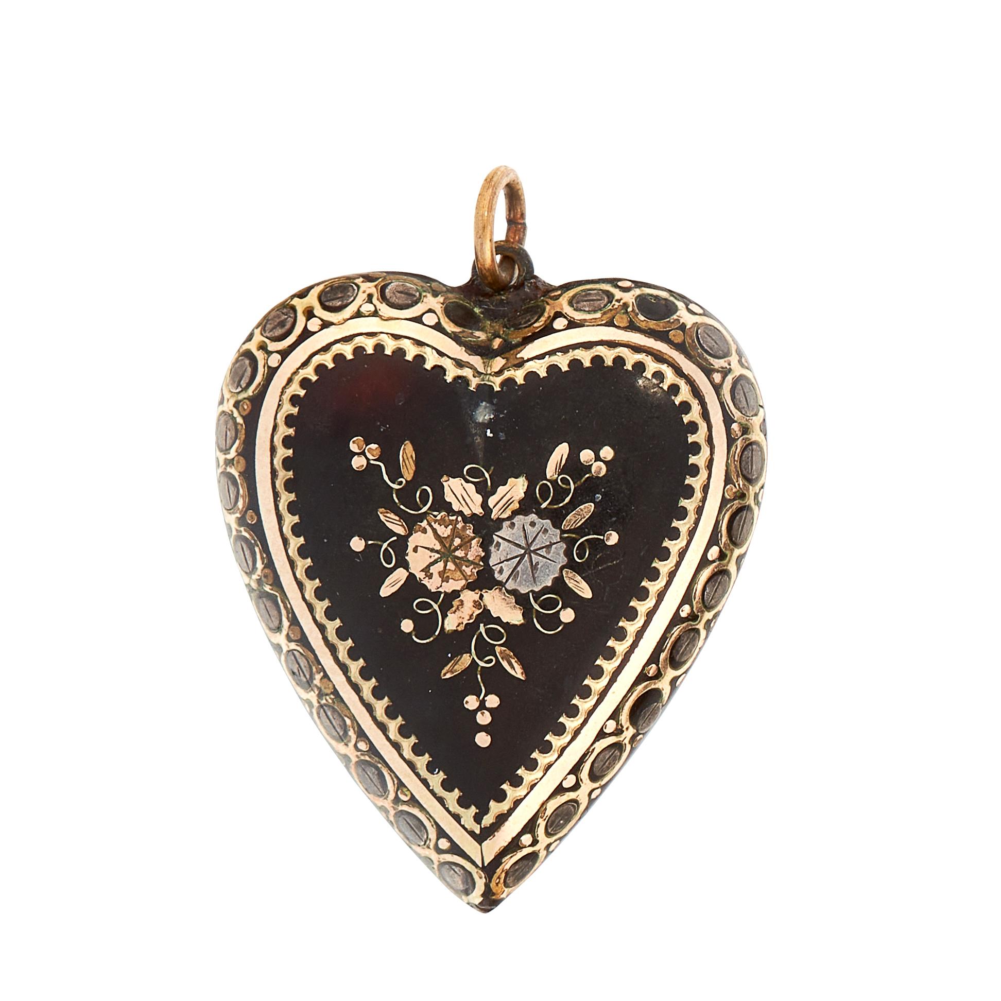 AN ANTIQUE PIQUE TORTOISESHELL PENDANT in heart shaped design, set with floral pique design,