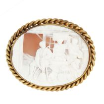 AN ANTIQUE CAMEO BROOCH set with an oval carved shell cameo depicting a scene of villagers around
