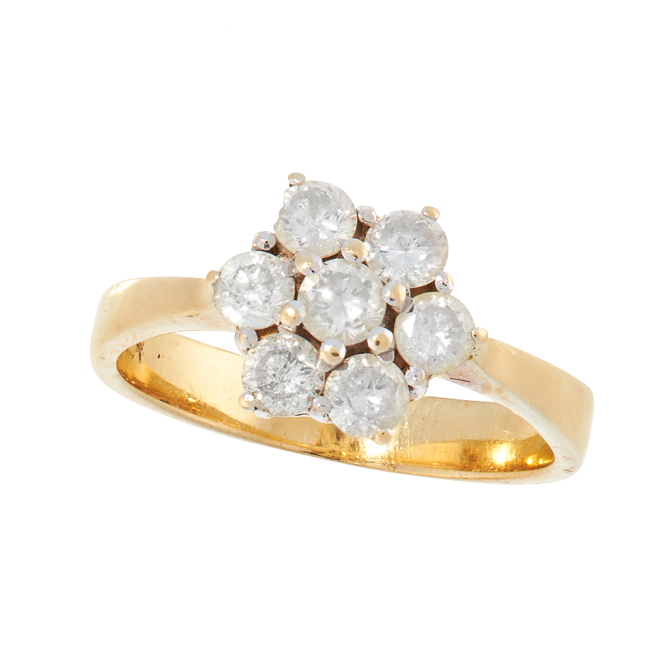 A VINTAGE DIAMOND CLUSTER DRESS RING in 18ct yellow gold, set with a cluster of seven round cut