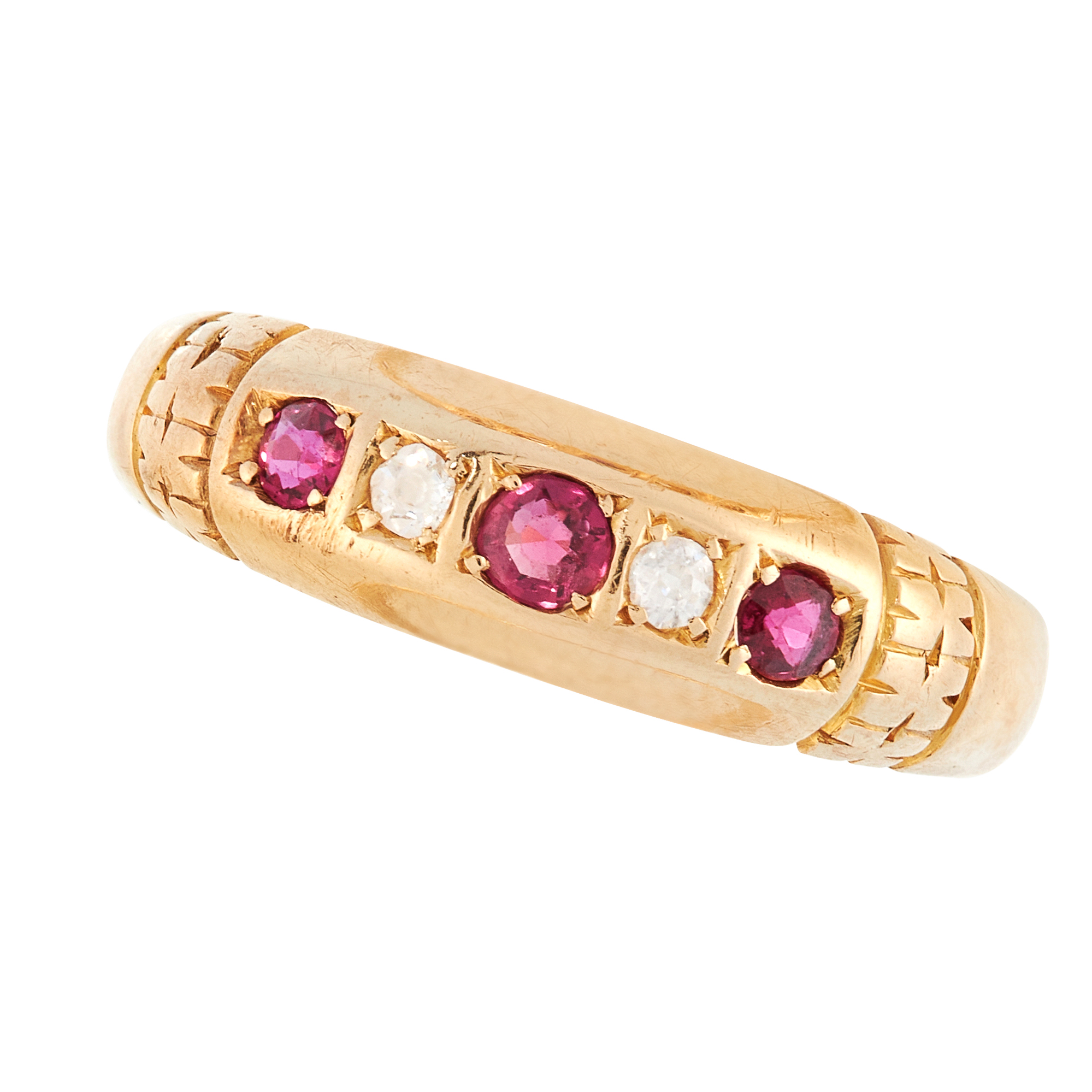 AN ANTIQUE RUBY AND DIAMOND DRESS RING, 1909 in 18ct yellow gold, set with a trio of graduated round