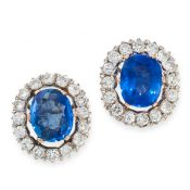A PAIR OF CEYLON NO HEAT SAPPHIRE AND DIAMOND CLUSTER EARRINGS each set with a cushion cut