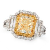 A YELLOW DIAMOND AND DIAMOND RING set with a radiant cut yellow diamond of 3.21 carats within double