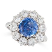 A CEYLON NO HEAT SAPPHIRE AND DIAMOND RING in platinum and 18ct white gold, set with a cushion cut