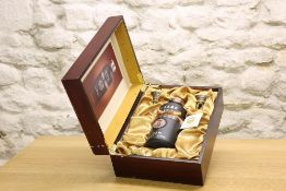 "1 EXTREMELY RARE 680 ml. BOTTLE KWEICHOW MOUTAI ""AGED 22 YEARS"" IN ORNATE PRESENTATION CASKET."