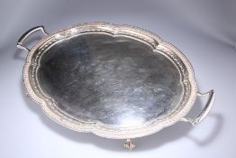 A SUBSTANTIAL SILVER TWO-HANDLED TEA TRAY