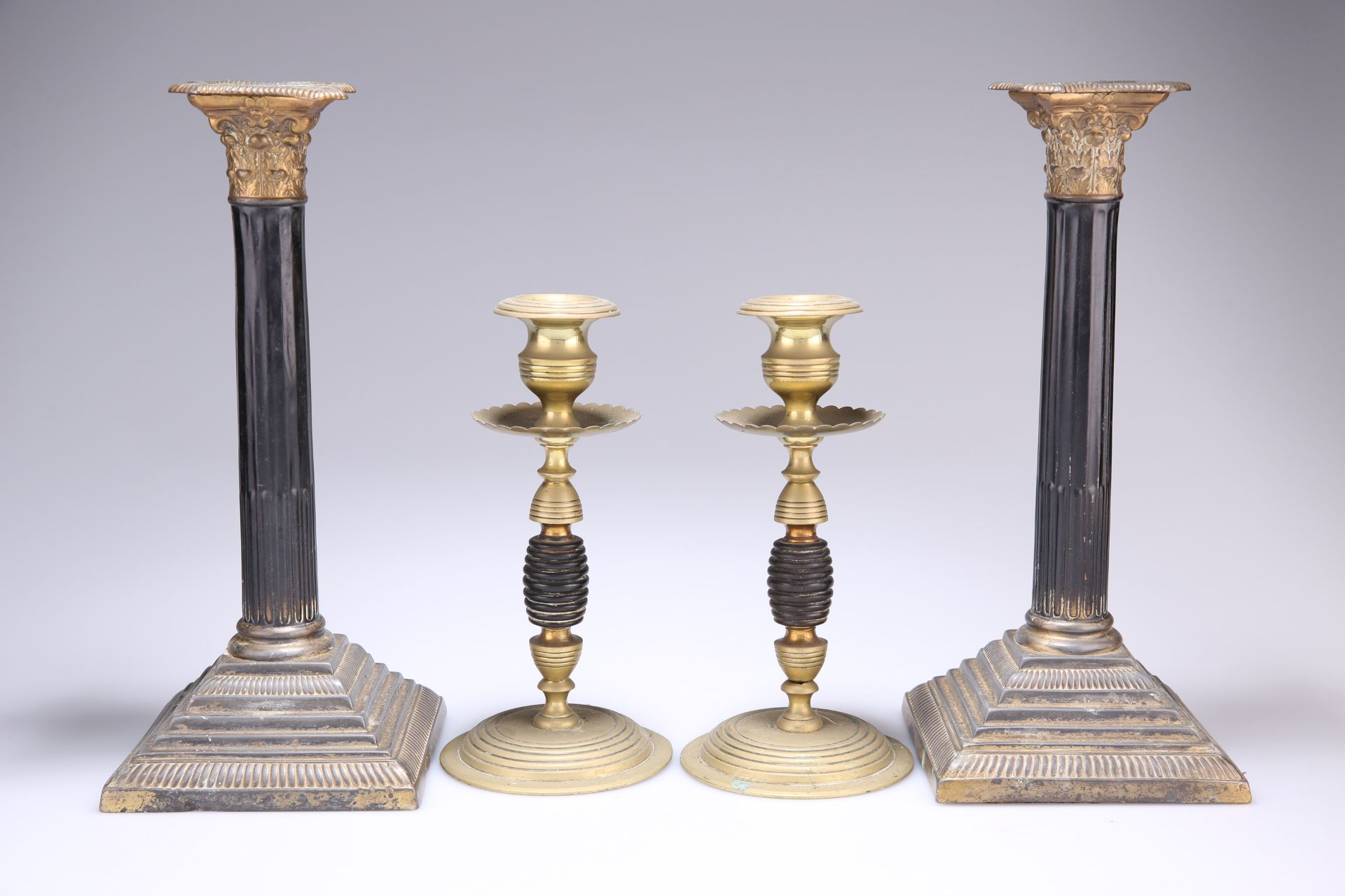 ~ A PAIR OF 19TH CENTURY GILT-BRASS AND LACQUERED CORINTHIAN COLUMN CANDLESTICKS, each with