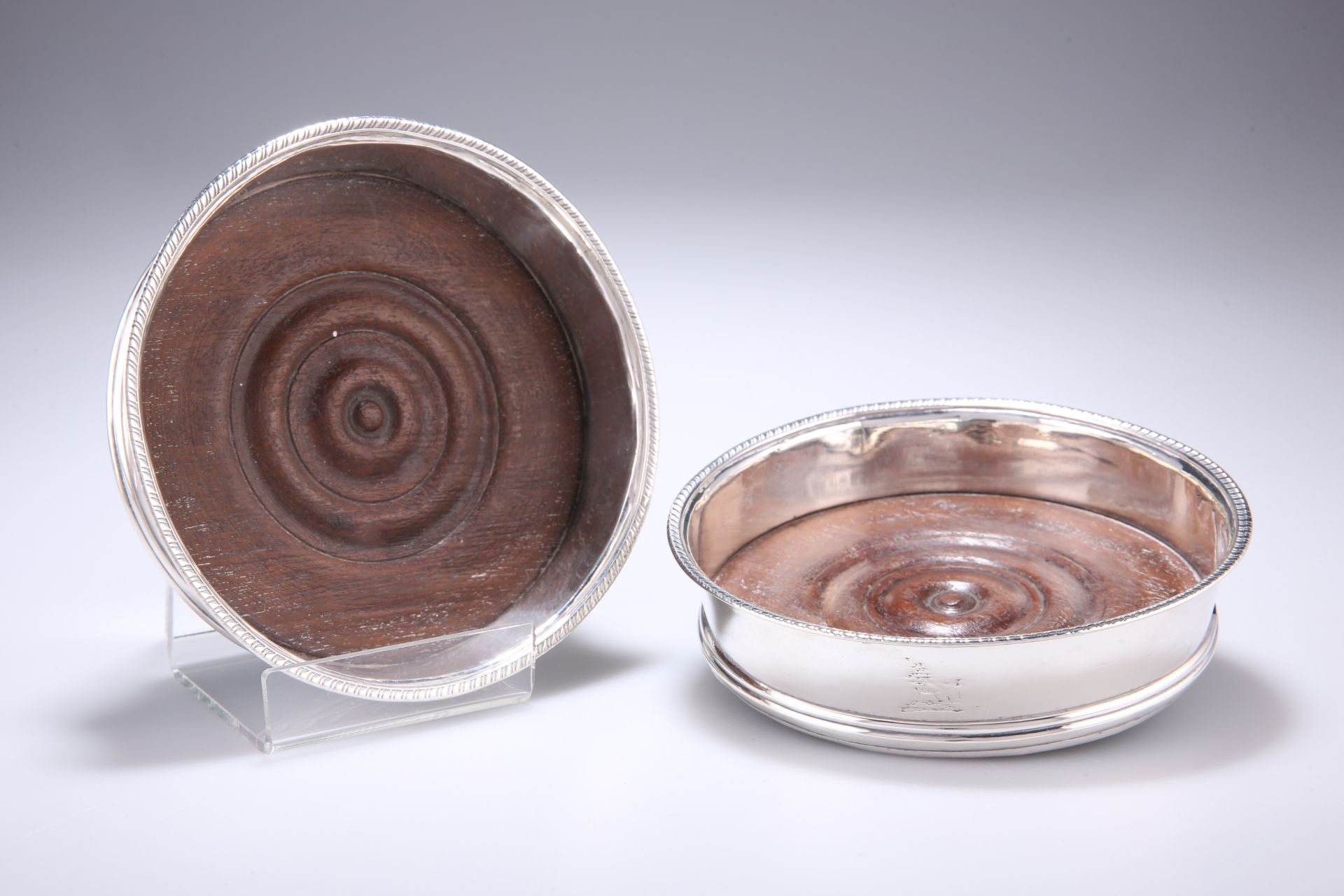 A PAIR OF GEORGE III SILVER COASTERS, marks rubbed, circular with gadrooned rim, each engraved