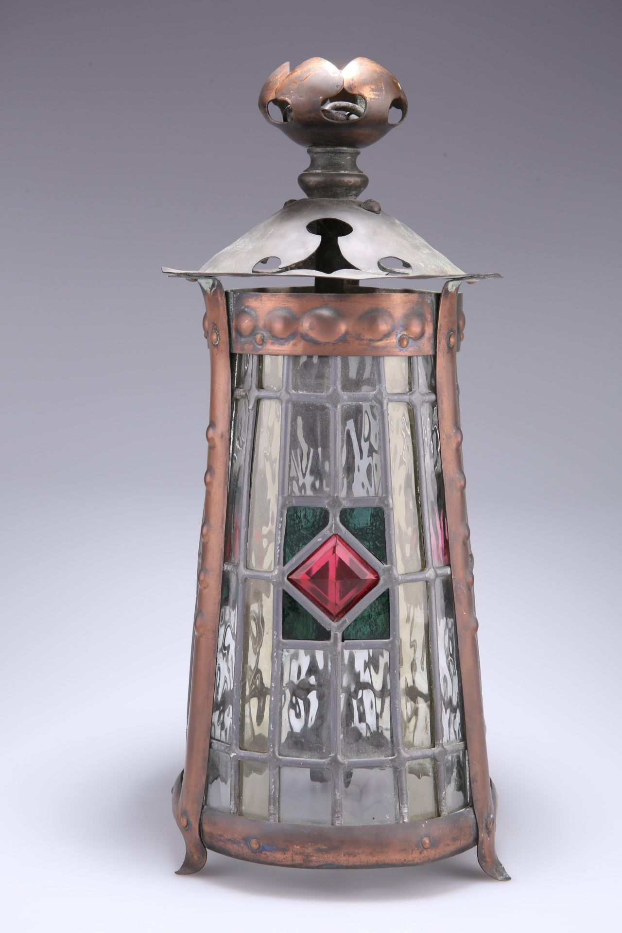 AN ARTS AND CRAFTS COPPER LANTERN, tapering cylindrical form, the three lead-glazed panels centred
