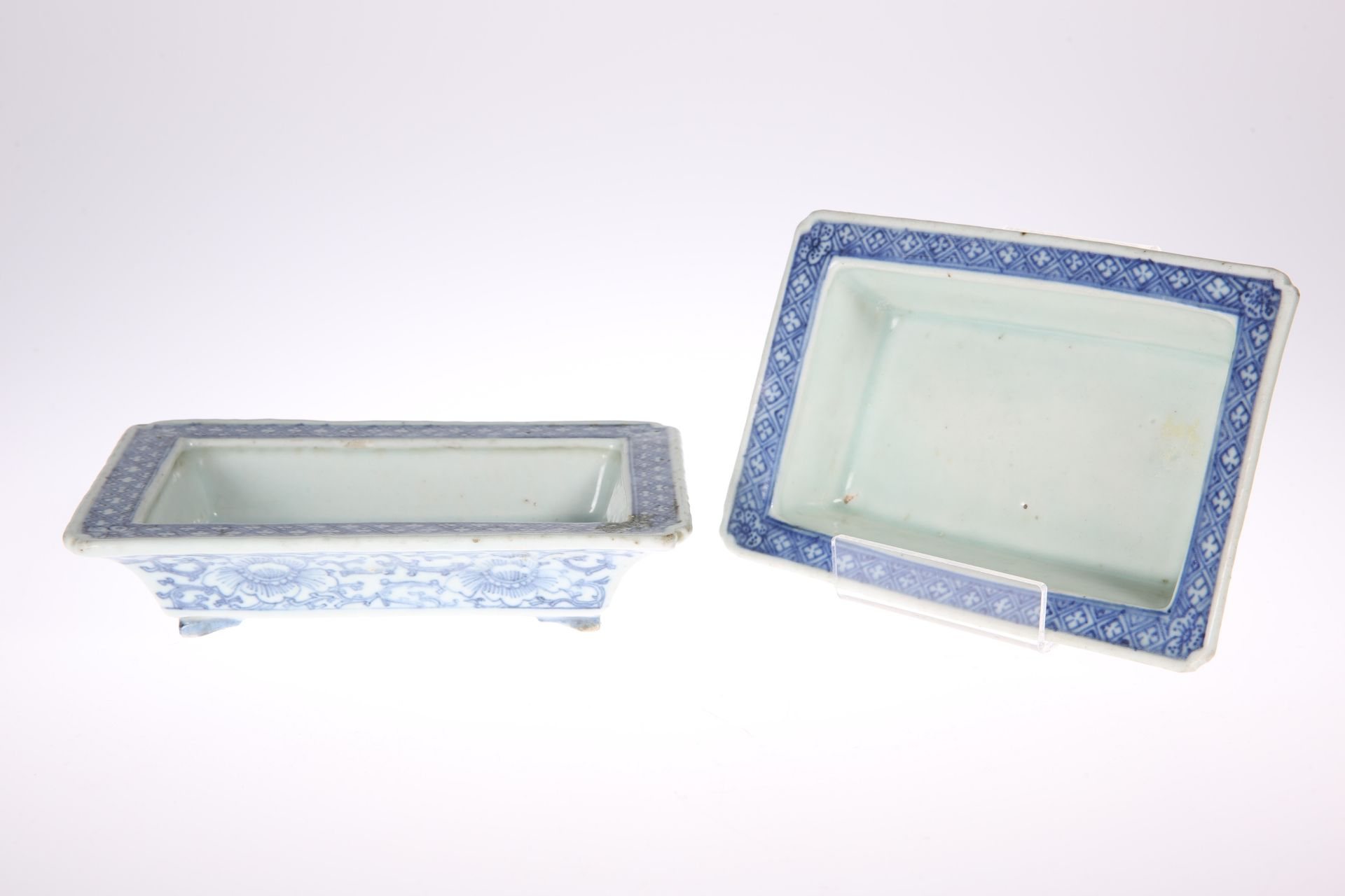 A NEAR PAIR OF CHINESE BLUE AND WHITE PLANTERS, rectangular with bracket feet, the exteriors painted