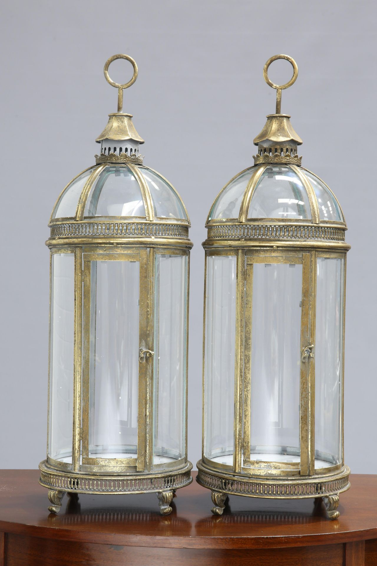 A PAIR OF PERIOD STYLE GILT METAL HANGING LANTERNS, each with domed top and hinged door. 78cm high