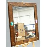 AN UNUSUAL ARTS AND CRAFTS OAK AND COPPER MIRROR, rectangular, to each corner an applied copper