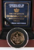"A 2018 GOLD PROOF FIFTY PENCE COIN, ""H.M. THE QUEEN'S CORONATION 65TH ANNIVERSARY"", no. 021, boxed"