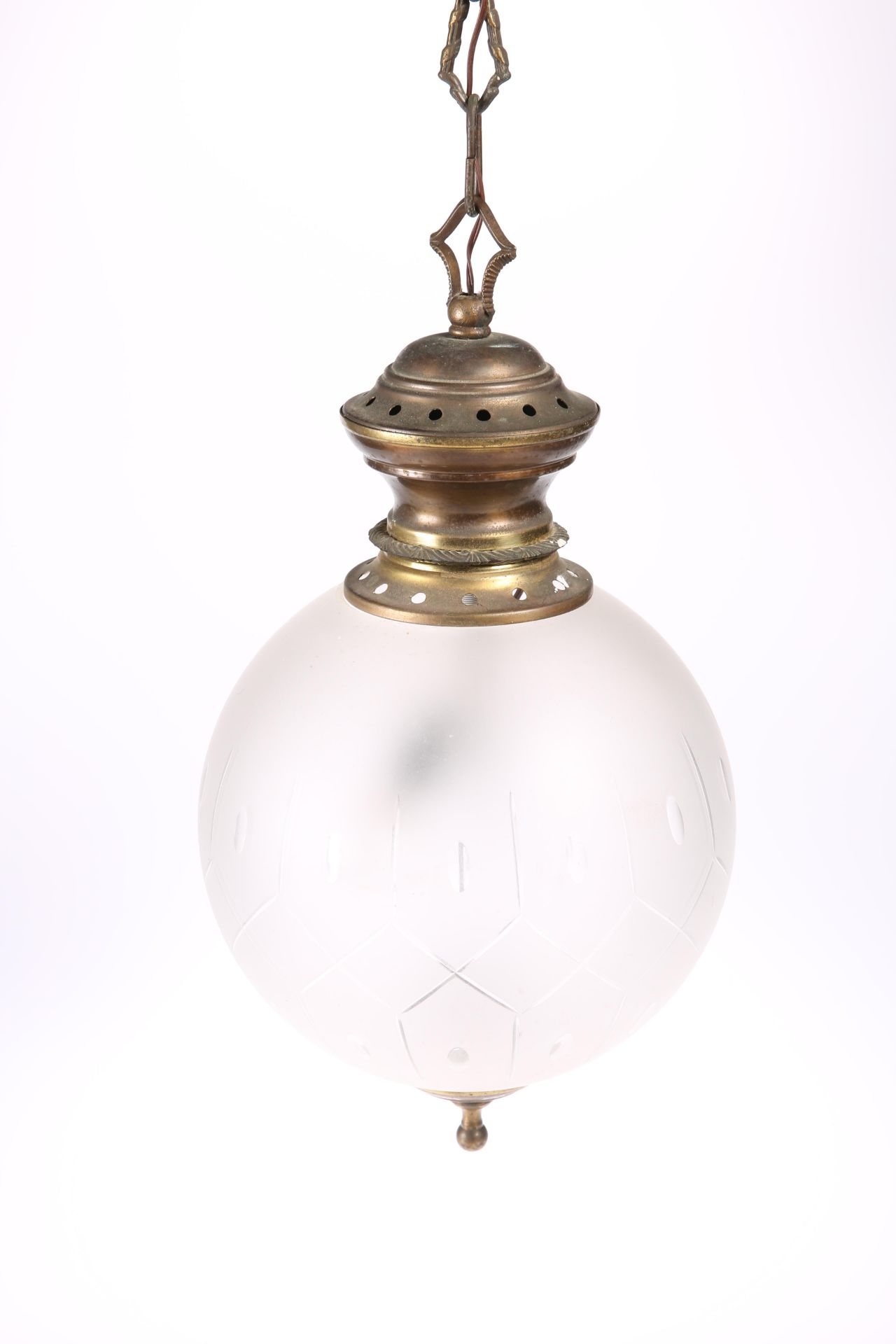 AN EARLY 20TH CENTURY BRASS AND FROSTED GLASS PENDANT CEILING LIGHT, the globular shade with oval