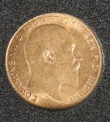 A 1910 HALF SOVEREIGN.