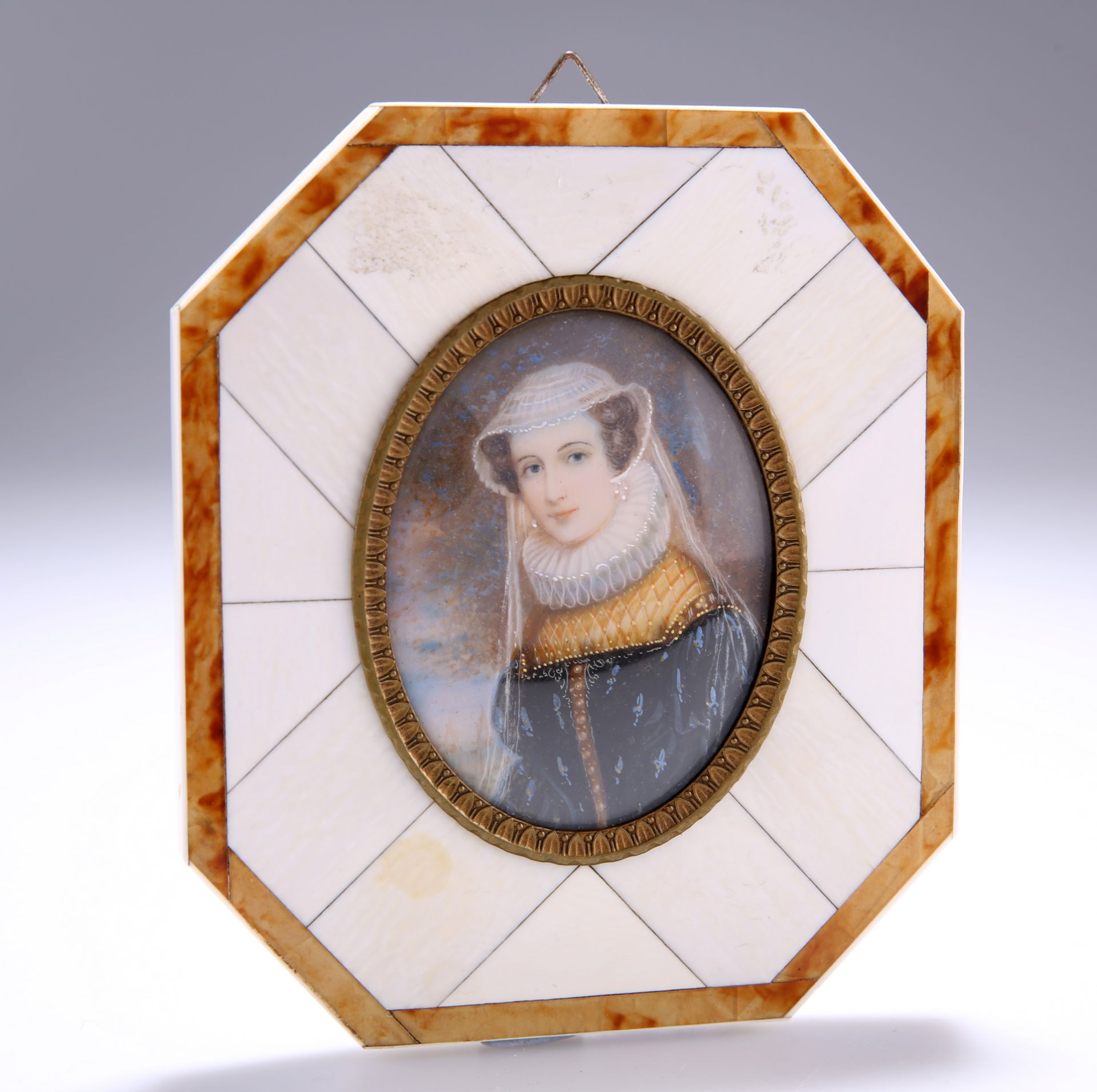 AN EARLY 20TH CENTURY PORTRAIT MINIATURE OF MARY STEWART, oval, watercolour on ivory, in an