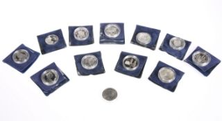 ELEVEN SILVER PROOF COINS, CIRCA 20TH CENTURY,in plastic capsules, total weight 10 troy ounces;