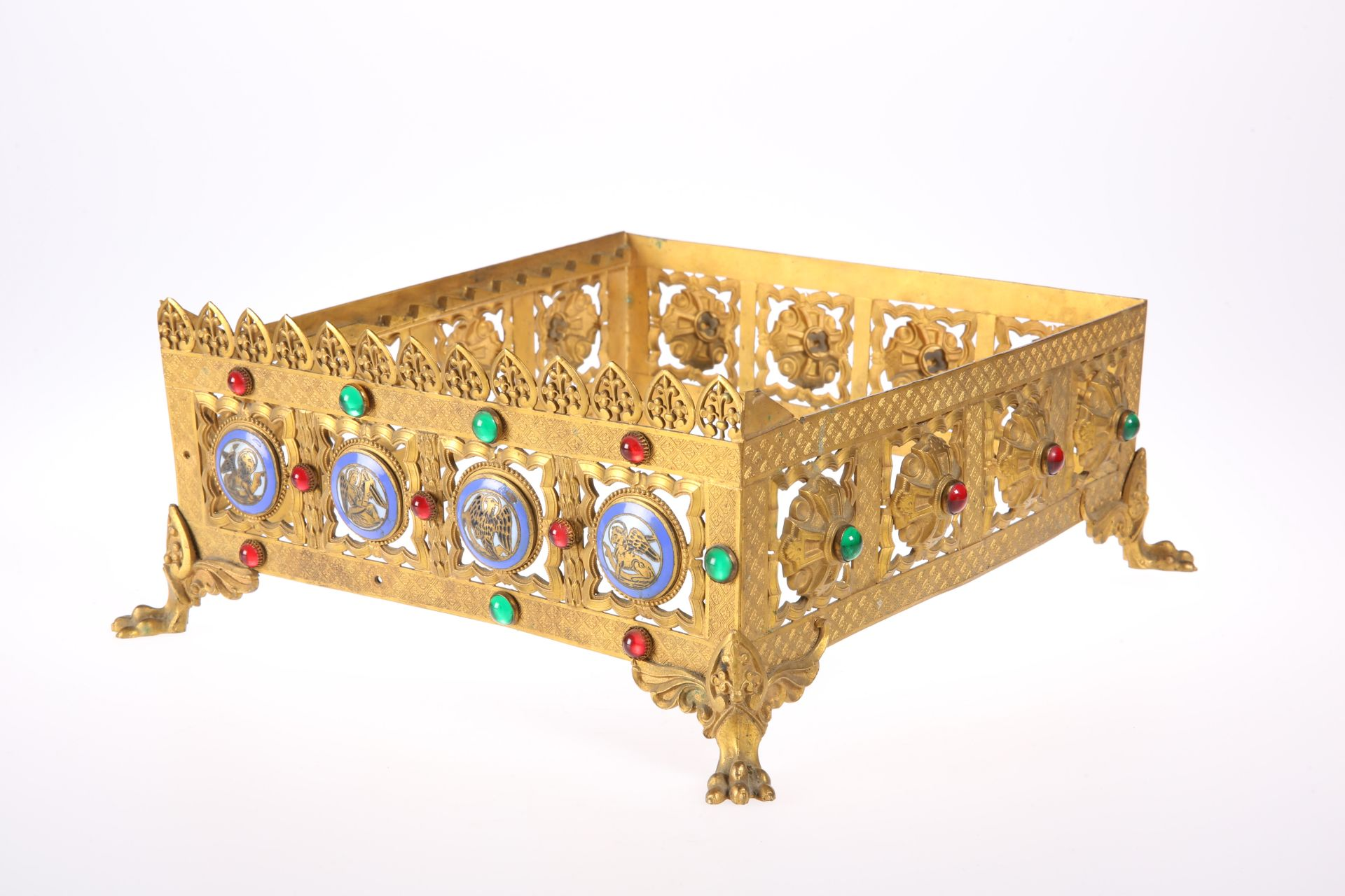 A GOTHIC REVIVAL 'JEWELLED' BRASS MISSAL STAND, CIRCA 1870, pierced square form, decorated to two