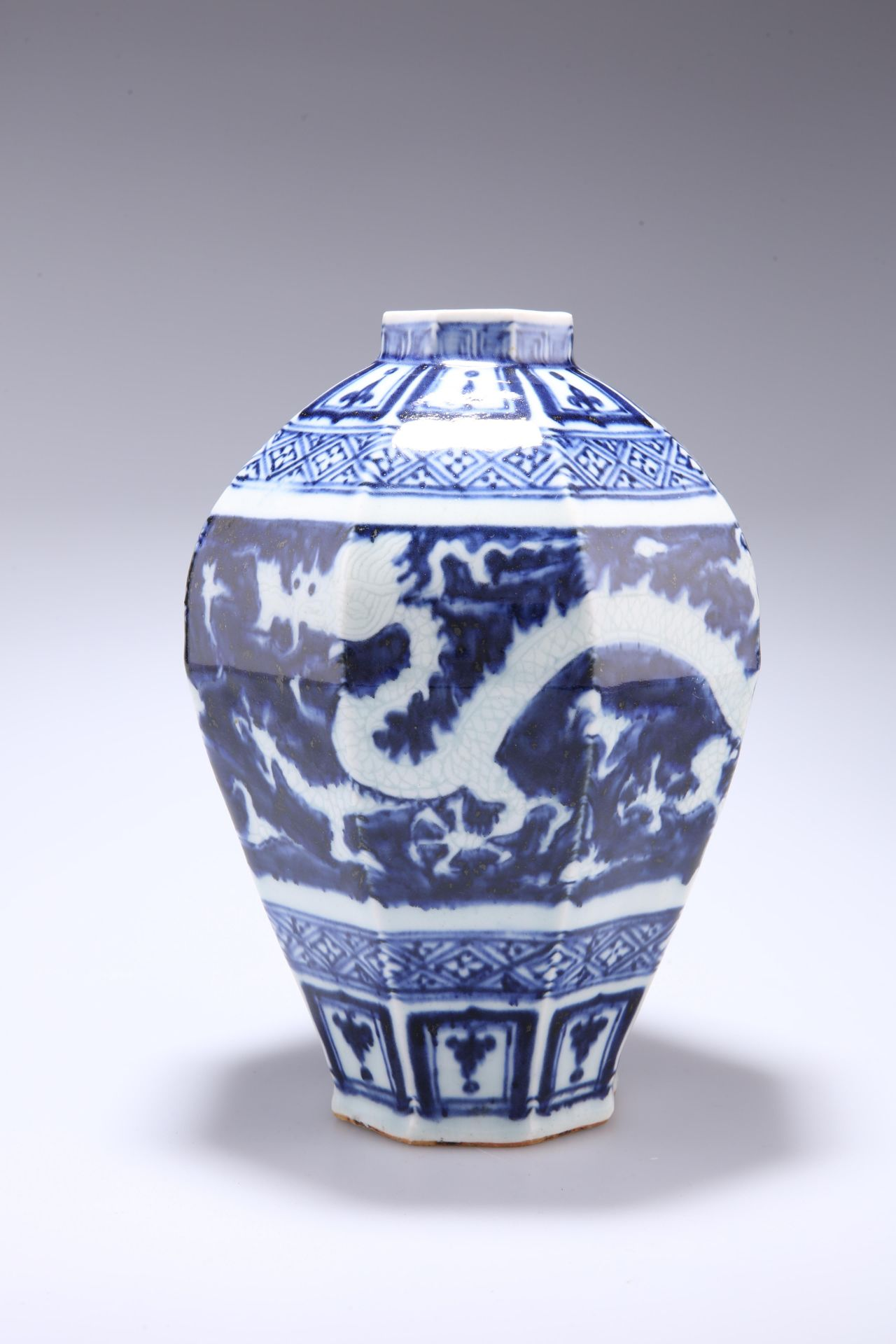 A PROBABLY 19TH CENTURY CHINESE BLUE AND WHITE VASE, inverted panelled baluster form, decorated with