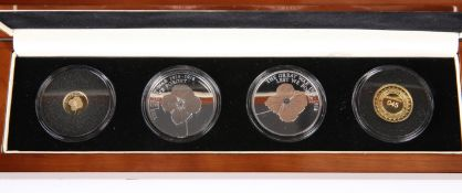 "A COMMEMORATIVE PROOF COIN SET, ""THE LEST WE FORGET ARMISTICE CENTENARY POPPY COIN SET"", including"