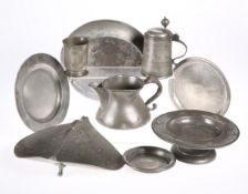 A LARGE COLLECTION OF ANTIQUE PEWTER, including an Irish haystack measure, stamped CORK; nine