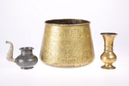 A LARGE ISLAMIC BRONZE BOWL, decorated with script; together with two other Islamic items, A POT