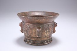 A BRONZE MORTAR, probably Spanish and 17th Century, with flared rim, the sides with lugs. 14cm