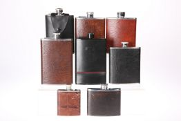 EIGHT VARIOUS HIP FLASKS, all leather covered stainless steel, with screw lids. 14cm high and