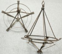 A PAIR OF WROUGHT IRON HANGING CEILING LIGHTS, CIRCA 1900, circular with whiplash shaped supports.