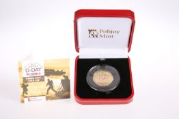 A POBJOY 22 CARAT GOLD D-DAY 75TH ANNIVERSARY FIFTY PENCE PROOF COIN, in plastic capsule, with