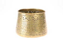 AN ISLAMIC BRONZE BOWL, with Islamic script circling the bowl and incised decoration around the