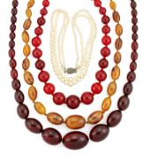 THREE FAUX AMBER NECKLACES AND A CULTURED PEARL NECKLACE,