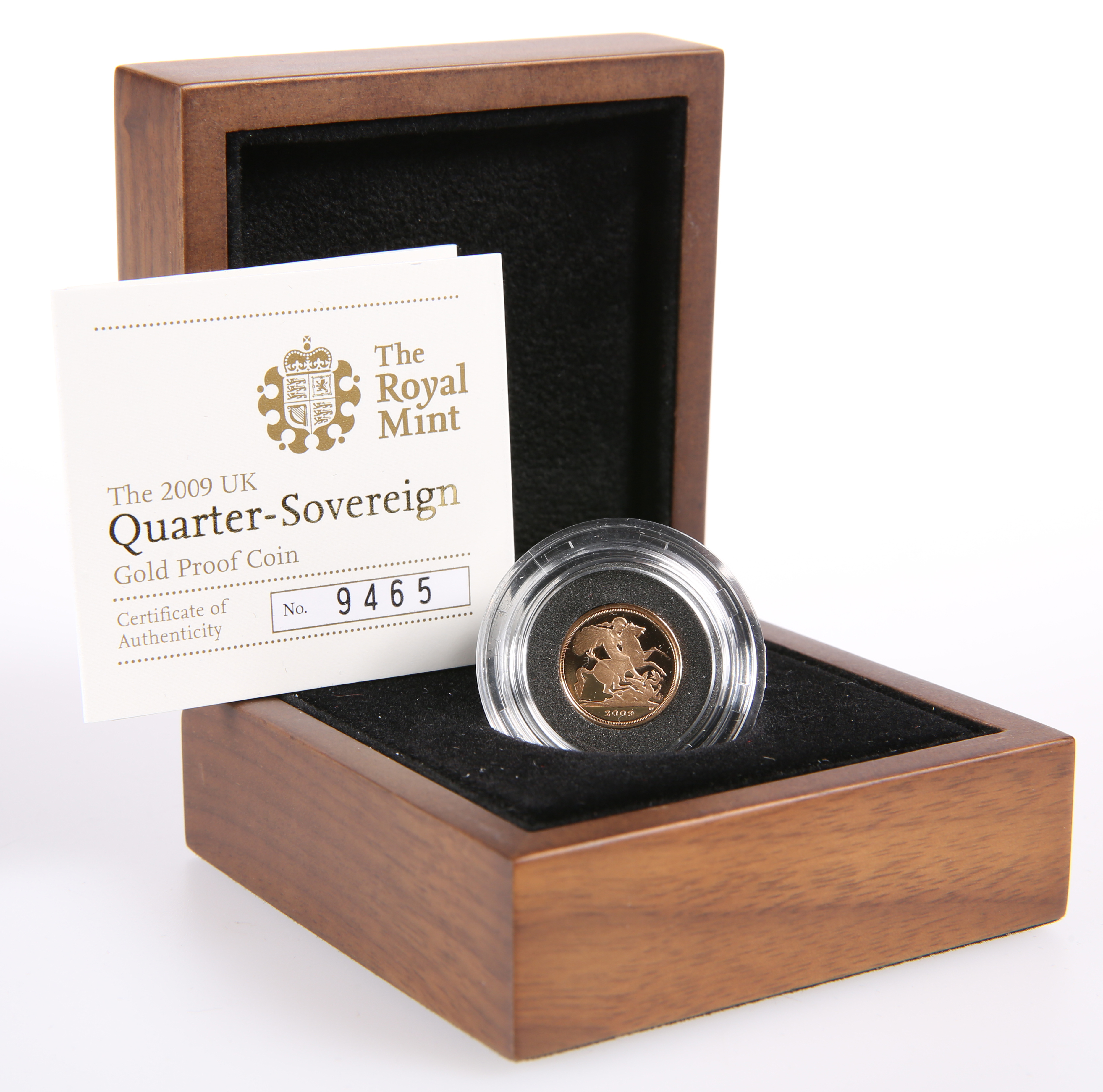 A ROYAL MINT 2009 QUARTER-SOVEREIGN GOLD PROOF COIN, boxed with COA no. 9465