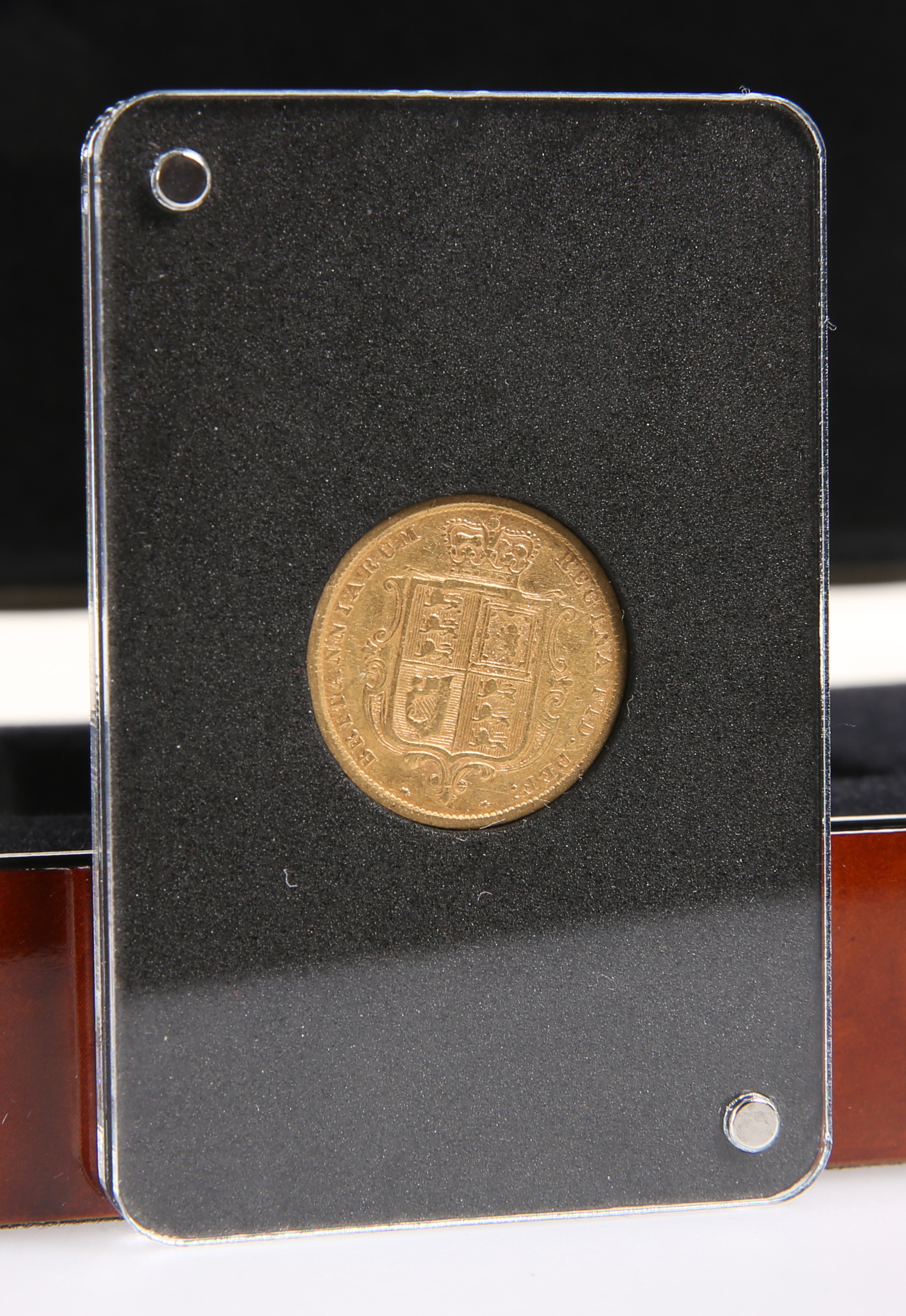 A VICTORIAN 1884 HALF SOVEREIGN, cased and boxed.