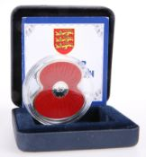 A 2012 £5 SILVER POPPY COIN, boxed with certificate.